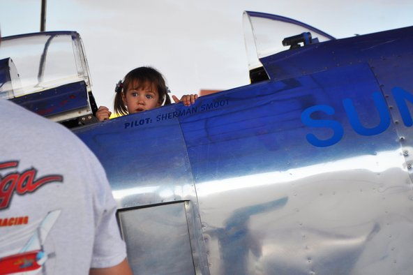 Little girl looking at airplanes at the Reno Air Races