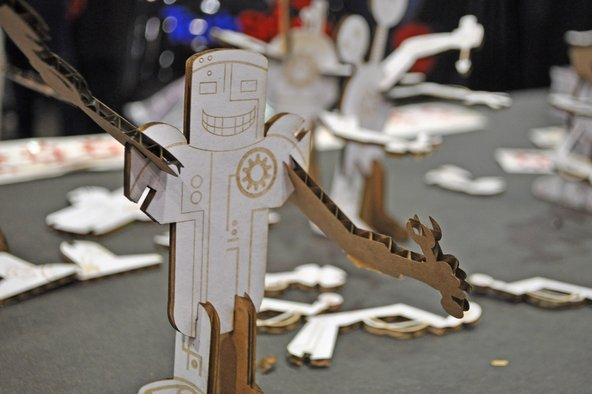 Cardboard laster cutout figurine at Maker Faire