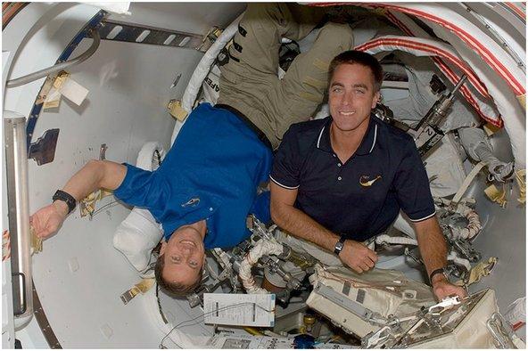 NASA repair technicians doing repair in space