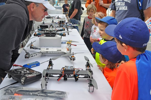 Kids looking at drones at Maker Faire