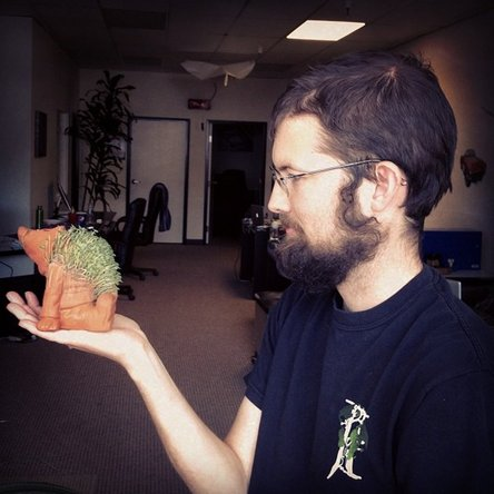 iFixit co-founder Luke holding a garden gnome