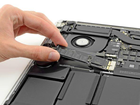 تفكيك جهاز MacBook Pro الجديد بالكامل والجهاز مستحيل تصليحه