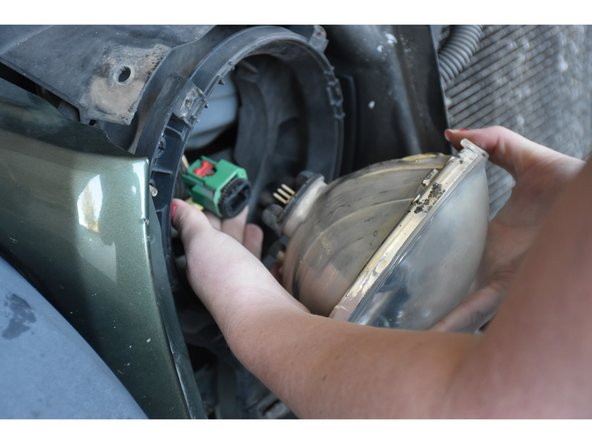 Firmly pull the connector away from headlight to remove.