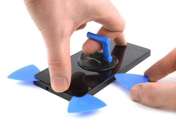 Take a third opening pick and insert the tip into the gap on the left side of the phone.
