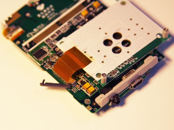 Image 3/3: The ribbon pin should snap completely off of the motherboard.