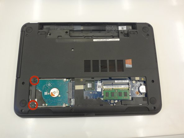 Locate the two hard drive screws, located on the left-hand side of the hard drive casing.