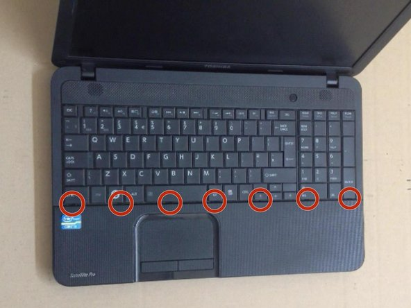 The Keyboard is held by 7x locking clips. Use cutter and plastic tools to unlock them.