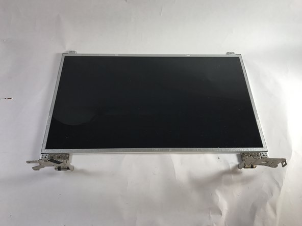 Using a Phillips 0 screwdriver, remove the 10 screws (M2.5 x 4.5) that secure the display panel to the display back-cover.