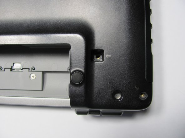 Image 2/2: Unscrew the 2 screws next to the battery