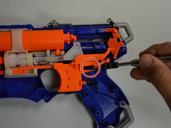 Remove the screw on the inside of the gun.