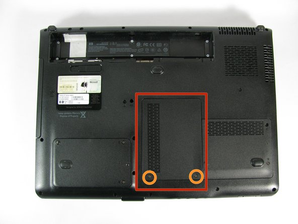 Locate the panel that lies in the front center of the laptops underside.