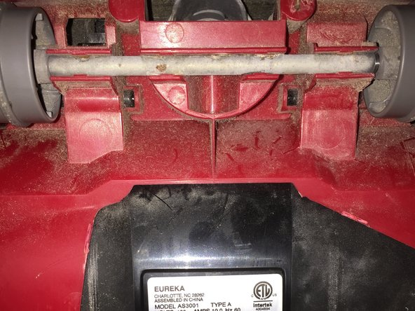 After the brush and belt housing is removed, the red wheel frame can be removed in a similar fashion.