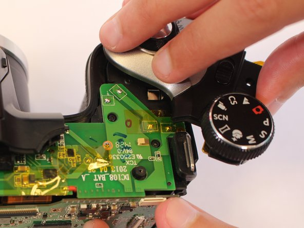 Rotate carefully to avoid breaking the screw attaching the top side cover to the main body of the camera.