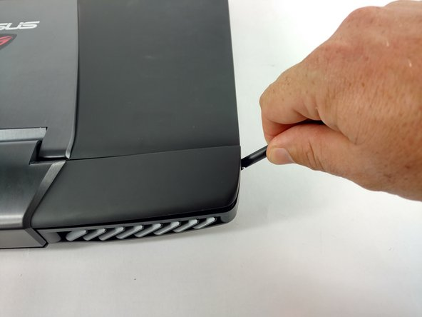 Image 1/2: Using a nylon spudger, carefully pry the top back panel off to reveal the speakers.