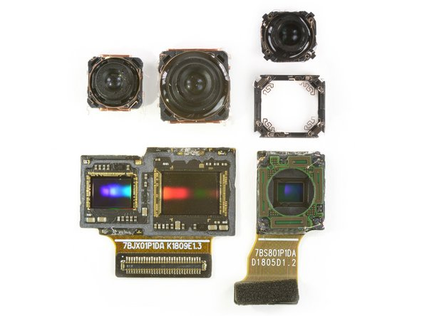 In the middle is the 1/1.7 inch RGB sensor, with the 1/2.7 inch monochrome sensor cozying up to its left. On the right we see the telephoto with a 1/4 inch sensor.