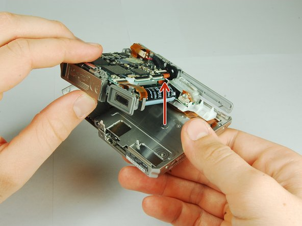 This camera houses a very strong capacitor (the black cylinder).  Avoid touching anything around the two wires coming out of the top.  Doing so will risk serious electric shock.