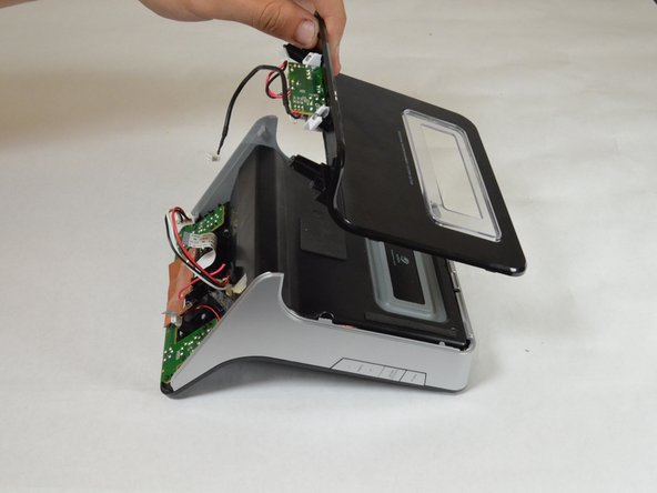 Slide the back panel towards top of the device and lift away from the device to detach back panel.