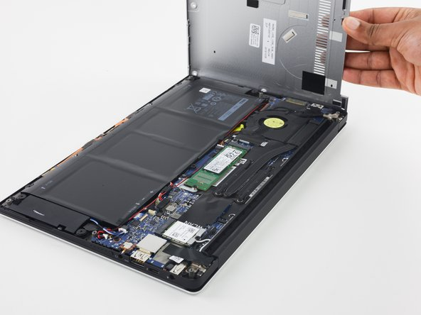 Removing the back cover is straightforward—remove the eight T6 screws and the single Phillips, then pry the back cover off.