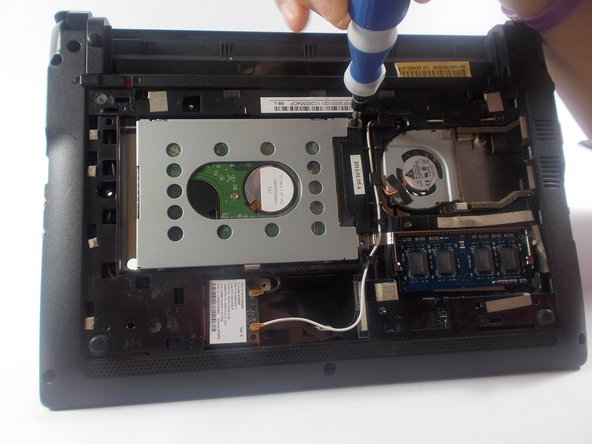 Remove the single 1.2 mm Phillips #1 screw from the Hard Drive.