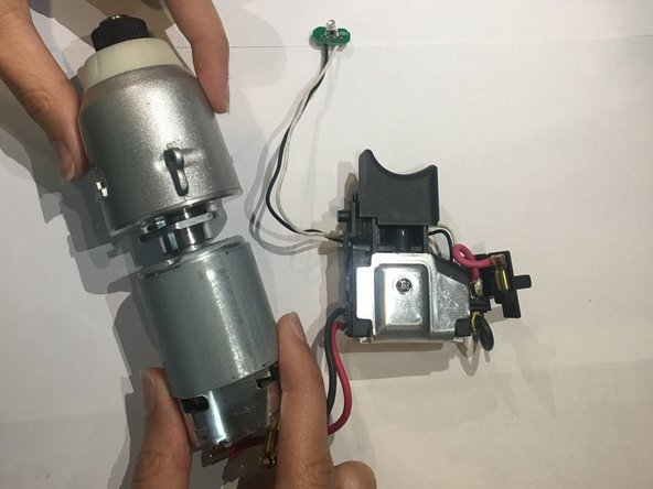 Pull both ends of the device to separate the motor from the rest of the device.