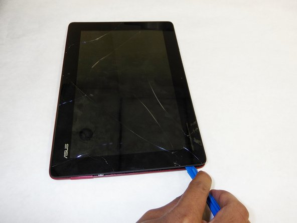 Use plastic opening tool to pry screen up and remove from outer casing.