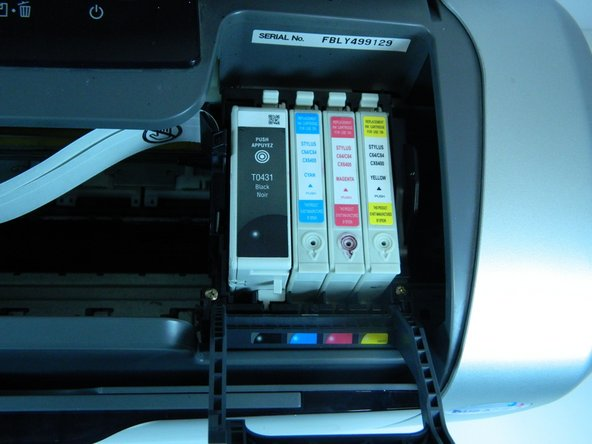 Image 3/3: Open the printer and move the carriage with the ink cartridges to the left so you have access to them.