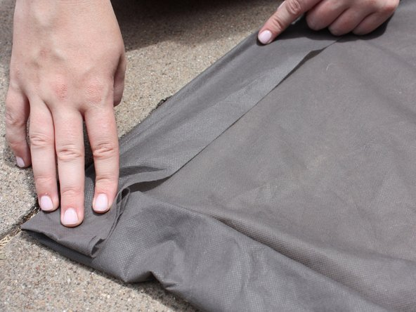 Fold under approximately a 1-inch allowance from the fabric's edges.