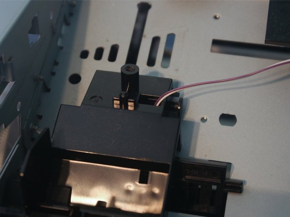 Remove 1 screw on the front of the cartridge connector.