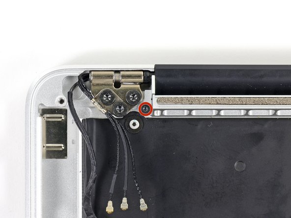 Image 1/2: Remove the 3.2 mm T5 Torx screws (one on each side) securing the aluminum hinge brackets to the upper case.