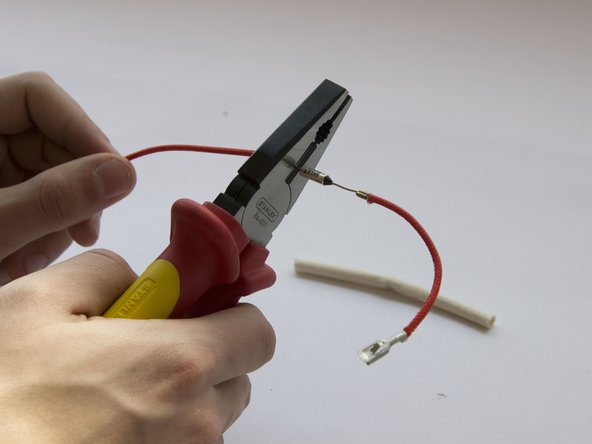 Cut the wire on both ends of the thermal fuse.