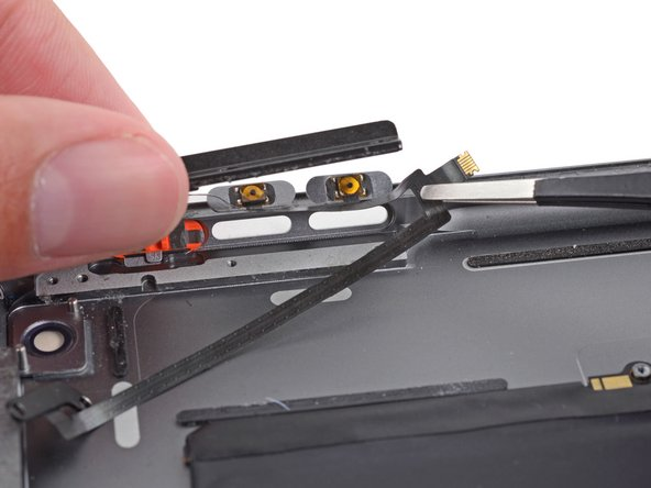 It may be useful to use a set of tweezers to lift the connector end of the cable.
