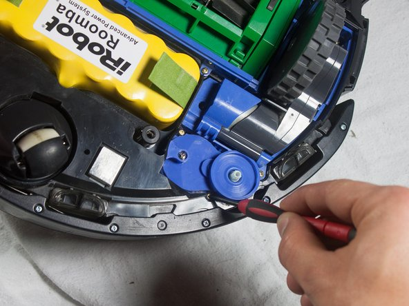 Use a Phillips #1 screwdriver to remove the two captive mounting screws on the side wheel motor assembly.