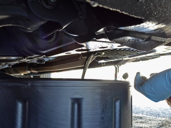 Use a 19 mm box end wrench or socket wrench to loosen the oil drain plug.
