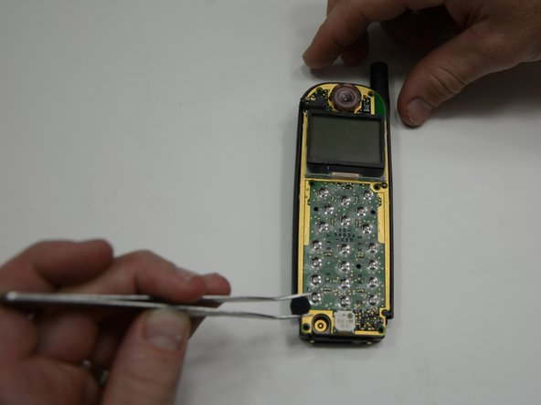 Image 3/3: using tweezers, Lift the microphone straight out of the phone.