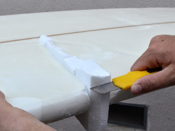 Trim down the overly excess pieces. Don't trim below the deck. This step will just make sanding a little bit easier.