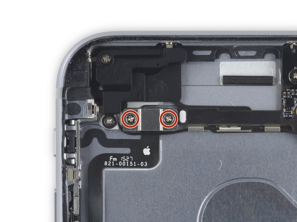 Remove the two 2.7 mm Phillips screws over the audio control cable bracket.