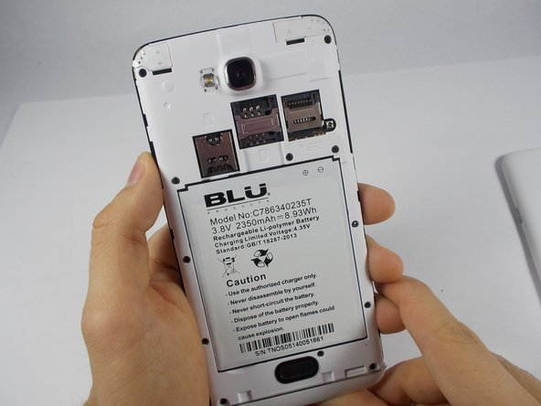 Once the back case is removed, locate the battery. It is the large brick embedded in the phone. It has BLU Products, a caution statement, and a barcode on it.