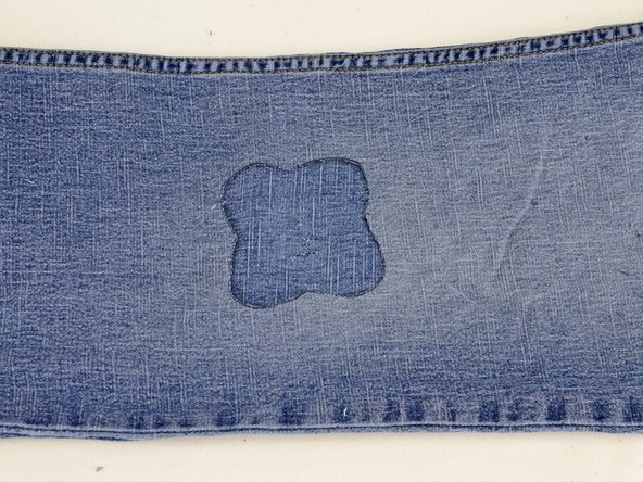 Be sure to only cut one layer of denim, or you will cut through the back of your jeans and need two patches!