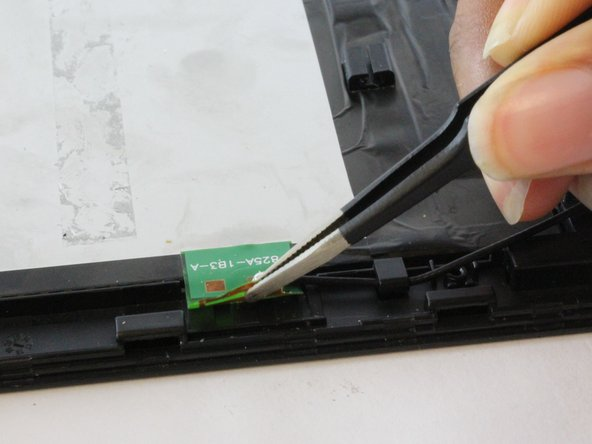 Disconnect the black cable from the small green connector using the precision tweezers.
