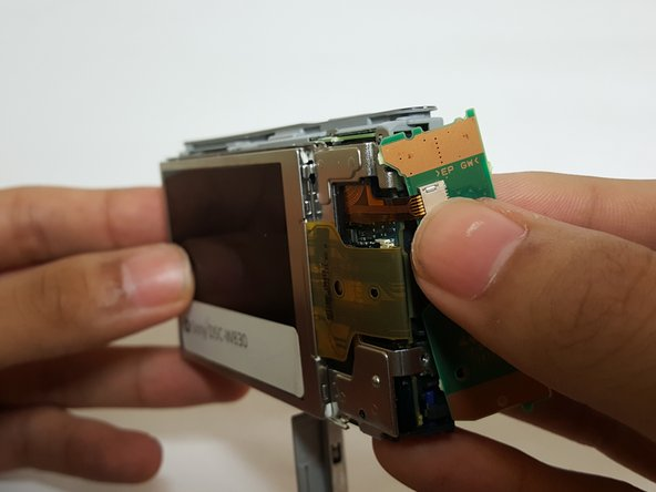 Be careful when lifting the LCD screen; the ribbon cable will still be attached.