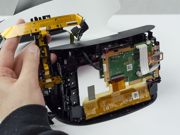 Image 3/3: Remove the yellow LED ribbons and black plastic connecting piece from the headset.