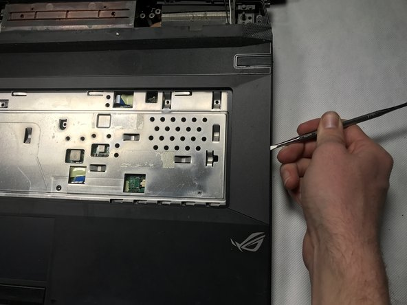 Image 1/2: Once the cover is completely unhinged, don't forget to detach the strips connected to the motherboard.