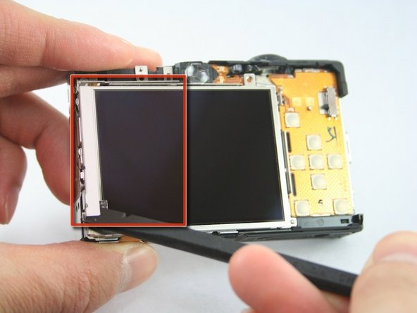 Use the spudger to remove the L-shaped bar from the left-side of the LCD screen.