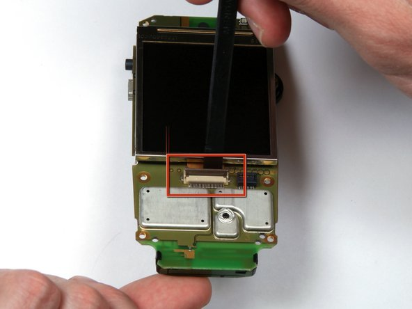 Image 1/2: Use a spudger to flip up the connector.