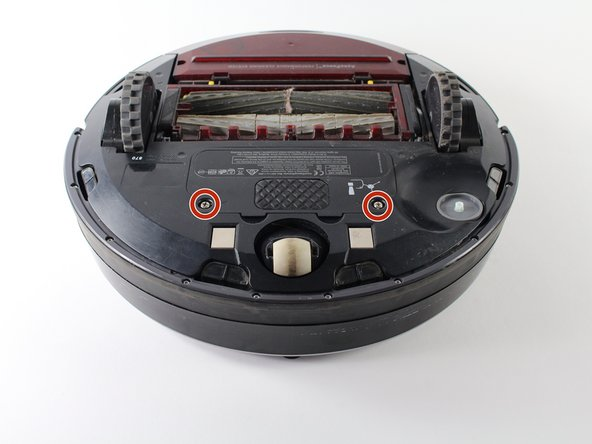 Remove the two 3.5mm Phillips screws that hold the battery cover onto the Roomba with a Phillips #0 screwdriver.