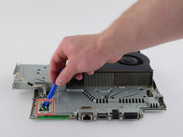 Image 1/3: Remove the wires from the hooks around the motherboard and fan cover to completely remove the antennas.