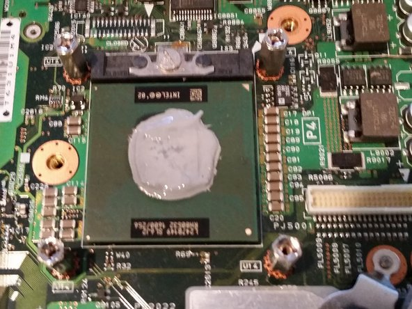 Image 1/1: Use a q tip to remove the majority of the thermal paste.