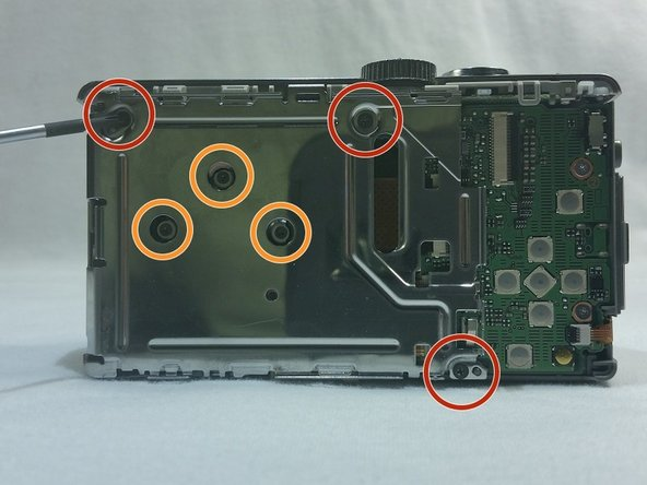 Remove the 3 Phillips 4mm screws located on the aluminum plating inside the camera.