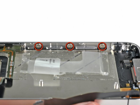 Image 1/2: It is not necessary to completely remove these screws. When reinstalling the display assembly, be sure the washers are closest to the screw head (as seen in the second picture).