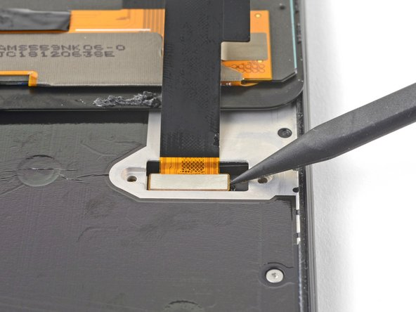 Use the point of a spudger to pry up and disconnect the screen flex cable.